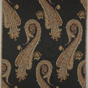 Length of woven fabric with a black ground and oversized multi-colored paisley motifs, facing in opposite directions in each off-set row.