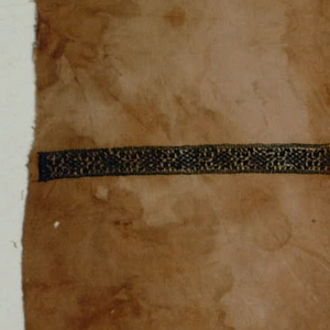 Single band of embroidery in dark blue.