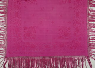 Silk shawl with fringe embroidered in same color.