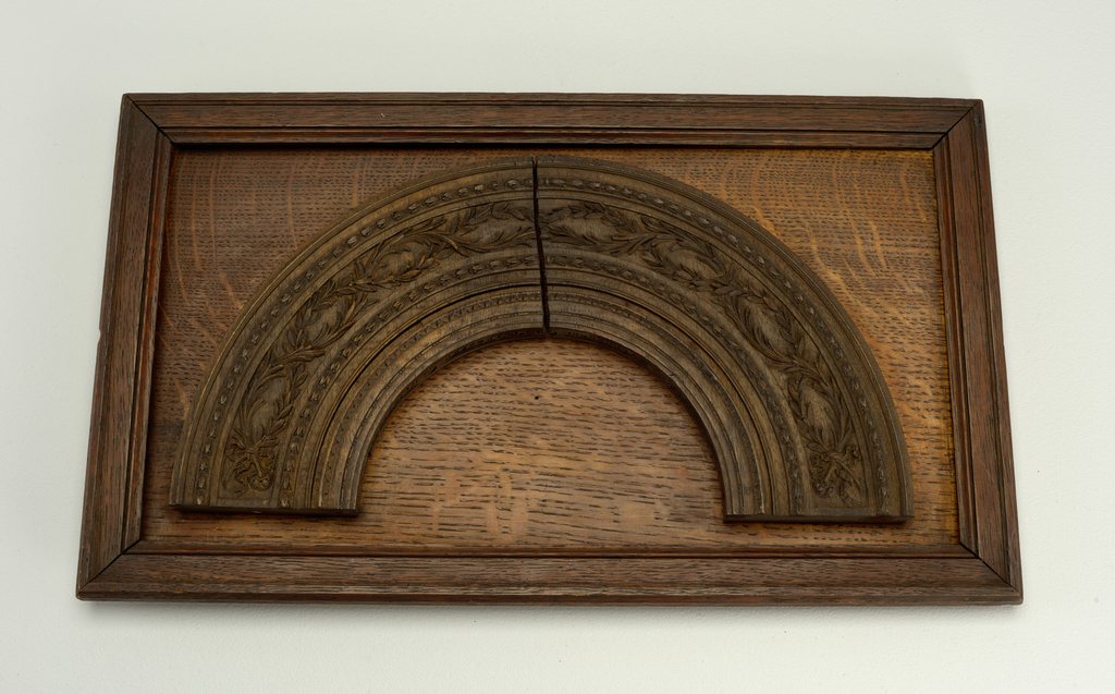 Semi-circular. Series of plain moldings, with frieze of olive leaves. Soffit carved with guilloches and rosettes.