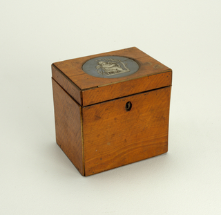 Wooden box with wedgwood round inset.