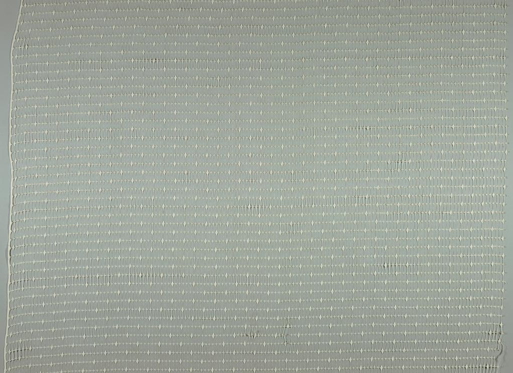 Sheer casement panel in a lacy, openwork design.