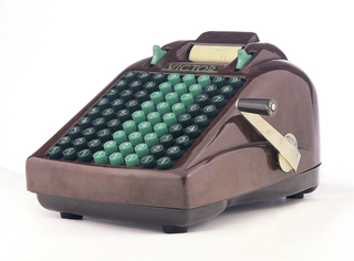 Contoured, rectangular mottled brown Bakelite housing with eight collumns of dark green and mint green number keys in ascending order from one at the bottom to nine at the top; metal cranking arm with painted wood handle on the right side; paper roll dispensing assembly at the front top.