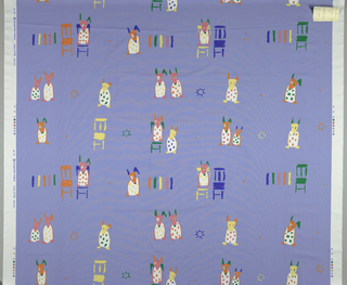 On a blue ground, three repeats of printed drawing of colorful dogs next to and on chairs.