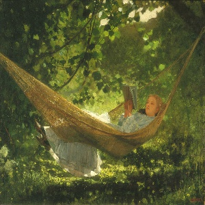 Horizontal view of a young woman in a white dress, lying in a hammock with her feet over the edge, reading a book. She is in a setting of sunlight-dappled trees and grass.