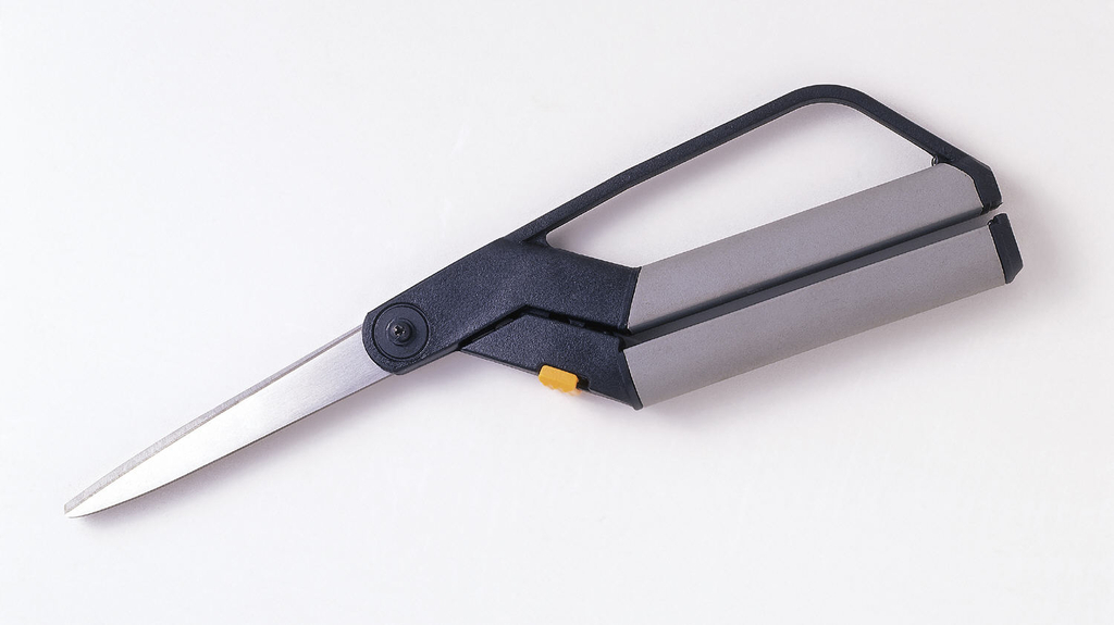 A pair of scissors with large rectangular black and grey handles.
