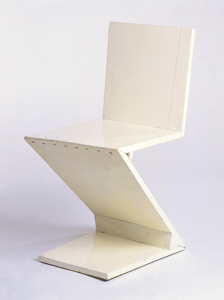 Z-form cantilevered chair constructed of wide planks; rough construction painted white.