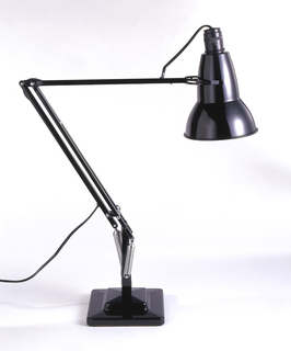 Black enameled lamp surmounting flexible arm on stepped square base; three springs near base.