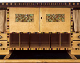 Rectangular four legged wood cabinet with two front doors opening into a desk. Bottom front of cabinet with decoration of vertical striped pattern; front doors, each decorated with an oval design of flowers, open front center to reveal desk equipped with multiple drawers and filing systems.