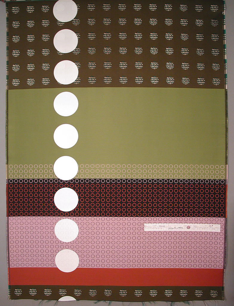 Length of woven fabric with wide horizontal bands of brown, greens, red and pink, some with woven patterns of dots or rings in varied sizes, over-printed with a column of large white dots.