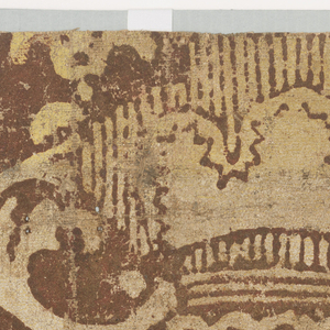 Horizontal rectangle with fragmental pattern of vase with scrolled handles, filled with stylized flowers and flanked by a stylized tulip border. The design is in yellow on brown flock. Exterior border of scrolled leaves in brown flock on yellow ground.