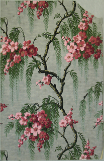Flowering cherry tree branches with weeping foliage. Printed in pink, magenta, green, black and gold on a mottled grey ground.