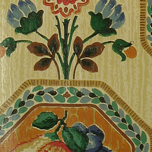 Needlework imitation fruit basket in octagon shape framework with leafy border.  A spray of flowers sits atop the octagon. Varnished surface. Printed in beige brown, blue, green, red, orange on a strie tan ground.