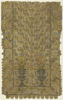 Embroidered wall hanging with silk and metallic-wrapped threads. Overall meandering floral motif with center motif of two metallic vases with flowers sprouting out. Edge is scalloped with each scallop holding a single flower.