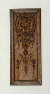 Carved with racaille motif of foliage and scrolls.  Set in simply moulded frames. One of two panels
