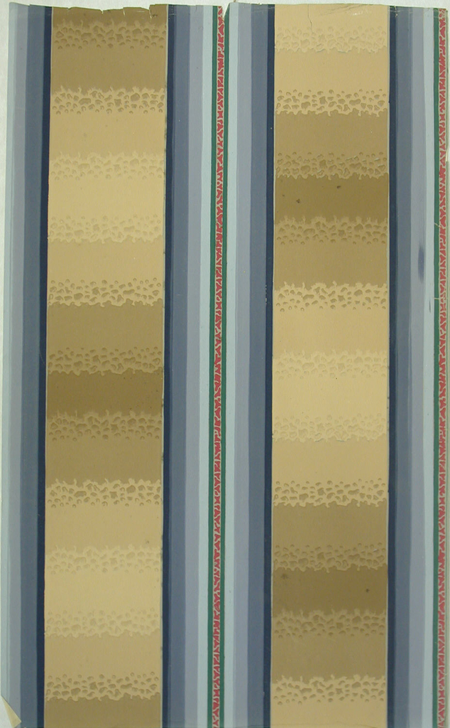 Central band of stripes between blocks of color in graduated shades with irregular pattern of pebbles; blue shaded stripe, dark brown , medium brown, light brown blocks of background color.
