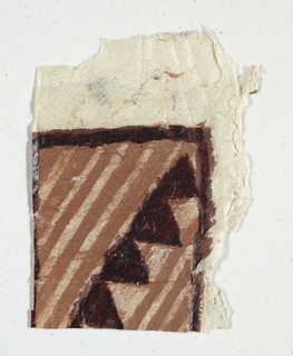 Painted and printed fragments of tapa cloth in brown