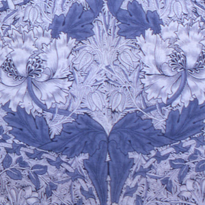 Large-scale symmetrical pattern of massive poppy-like flowers with curving stems to form ogival framing, in white and blue with deep blue outline on a deep blue ground. Wide plain selvedges. Printed around 1900.