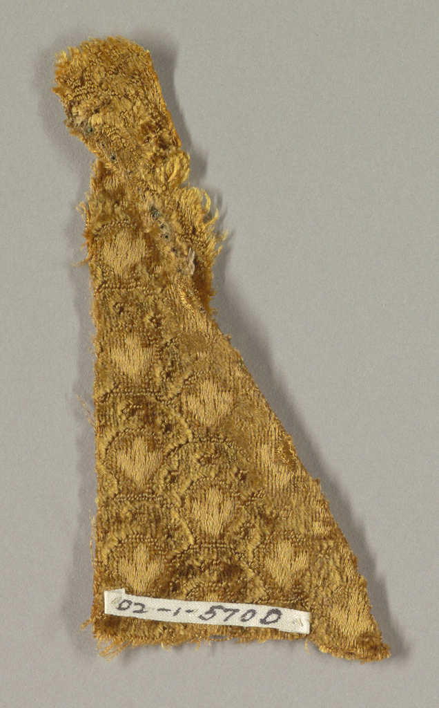 Imbricated or fish-scale pattern in brownish yellow