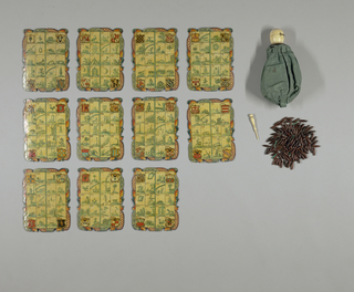 Rectangular board (1953-24-3m), one part of a game set (1953-24-3a/o). Board painted in polychrome colors, gilded and varnished, with curves and counter-curves cut out along all four sides, with 20 decorated, rectangular sections, numbered 181 thru 200, divided into 4 columns. Number 181, at top left, features coat-of-arms; 182 of bird on a branch; 183 of building, possibly fortress or possibly a lantern; 184 of a formal garden; 185, at bottom left, of a coat of arms; 186, at top, of spherical vessel with plumes; 187of nude female submerged in water and flanked by dolphins; 188 of amphora; 189 of soldier crouched behind shield; 190 of animal with outstreched arms, possibly statuary, perched on pedistal; 191, at top, of rifle; 192 of light house; 193 of soldier with flag perched on long rope; 194 of butterfly and branch; 195 of gate; 196, at top right, of coat-of-arms; 197 of tree with ladder; 198 of wooden bucket; 199 of pole with 2 small, flag-like elements attached to horizontal piece at top; 200, at bottom right, of coat-of-arms. Each of 4 different coat-of-arms painted in variations of red, gold, yellow, black and green; all other sections painted in shades of green. Decorated frame features various ornamental motifs including scrolls and lace-like patterns, all painted in colors including blue, orange, red and white. Reverse backed with paper featuring delicate dark red flowers on alternating bands of green and white. The set comprises: -3a)  Egg-shaped ivory box, hinged in half and opening by push-button.  Circular openings at top and bottom.  Screwed to -3b) a circular base of wood, to which a green taffeta bag is fastened, containing 120 spindle-shaped wooden beads, each with a rolled piece of green parchment inside, with a number.  -3c) Ivory stick with turned handle. -3d to n)  Eleven cardboard boards, with 20 decorated rectangles on each, painted with coats-of-arms in corners, and various implements in rest of rectangles.