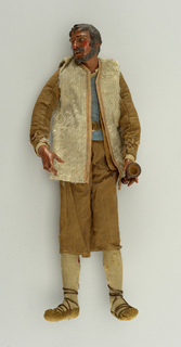 A man in brown linen knee trousers, light tan plush outer coat, also brown linen inner coat, laced in front; blue shirt, tiny buttons, brown leather belt, long linen hose, sandals. In left hand he is holding a musical instrument.