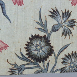 Design of vines and flowers. The outer parts of the design are vertically symmetrical; the central motifs are not. Indian adaption of a European woven fabric.