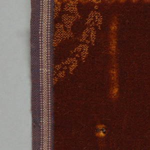 Swatch of monochromatic wool velvet that is patterned by the juxtaposition of cut, uncut and voided velvet.