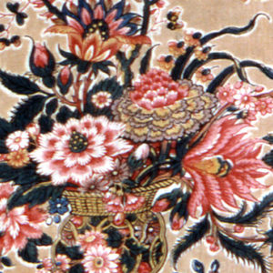 """On light tan """"tea ground"""" is a large repeat of an exotic vase containing an elaborate bouquet of fantastical flowers printed in red, yellow, blue and """"double green"""" of blue printed over yellow. High quality of printing."""