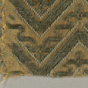 Chevron pattern in blue cut and uncut pile on yellowish-tan ground.