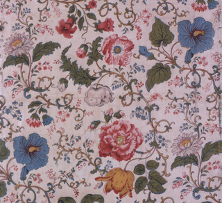 White ground showing an incomplete repeat of life-sized flowers on twining, leafy stems. Red, yellow, green (yellow on blue) and bright blue. Reprint using blocks from the first half of the 19th century.