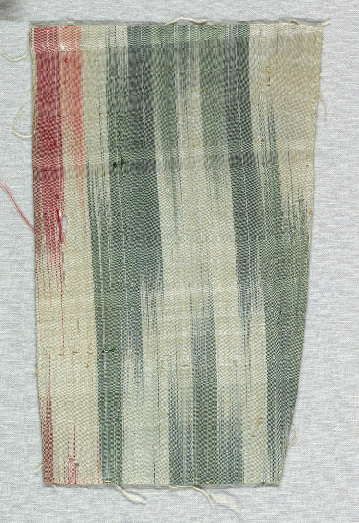 """Ikat-like warp stripes in two shades of pink, magenta, yellow and green. Component """"e"""" has applied yellow silk fringe. Components """"d,g"""" have ikat-like warp stripes in green and blue."""