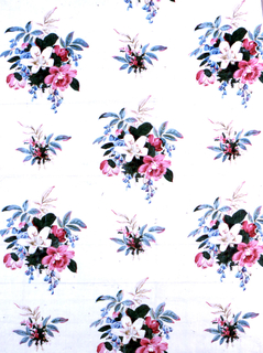 Plain white ground showing large, widely placed clusters of flowers with a white lily in the center. Printed in polychrome.