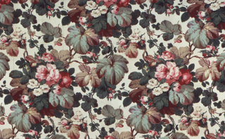 Heavy cream-colored cotton with large allover design of flower clusters and heavy foliage in red, green, yellow, violet and gray.
