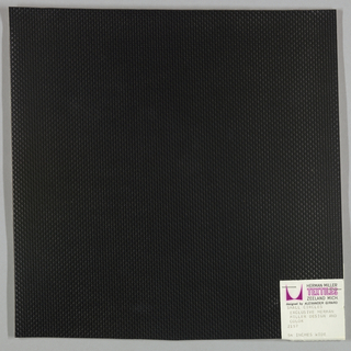 Vinyl-coated cotton knit in black, embossed in an all-over pattern of small circles. Number 2157.