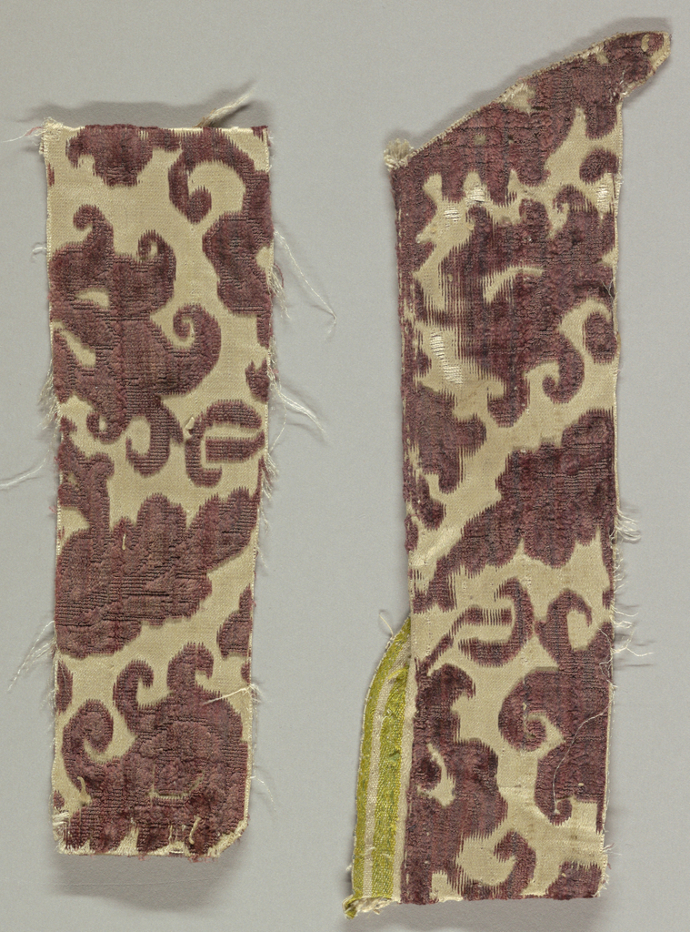 Fragment of deep purple cut and uncut velvet on white satin ground. Design of branches with blossoms and leaves alternately turning left and right.