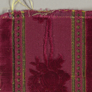 Fragments of coach lace in dark red, gold, green, and white with floral and geometric patterning.