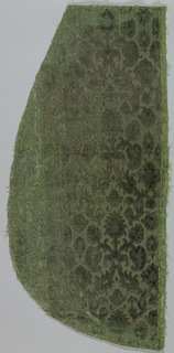 Panel of green cut and uncut velvet in a pattern of palmette and foliage.