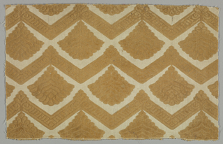 Light brown velvet, cut and uncut, with a cream-colored ground in fan shaped motifs between horizontal zigzag bars.