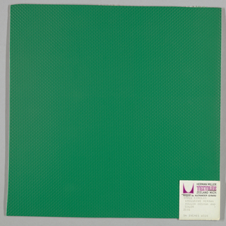 Vinyl-coated cotton knit in green, embossed in an all-over pattern of small circles. Number 2151.