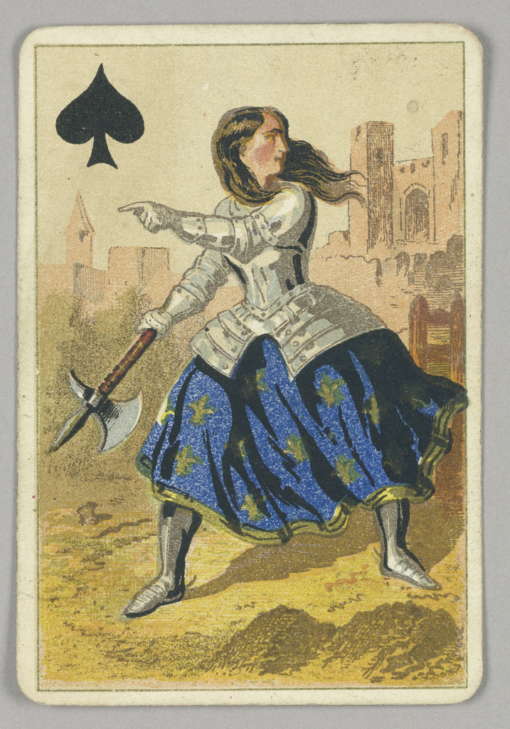 Queen of Spades court playing card from a pack of transformation playing cards. Female figure of Joan of Arc shown dressed for battle, wearing armor over a blue and yellow skirt decorated with fleurs de lys. She holds an ax in her right hand and points with her left hand. Architecture in the background.