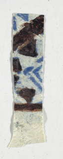 Painted and printed fragment of tapa cloth in blue.
