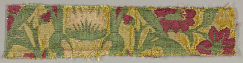 Fragment of a floral pattern in red, pink, yellow and green.