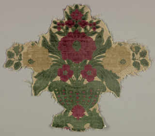 Four pieces cut from a larger cloth showing isolated polychrome flowers in an urn on a white ground.