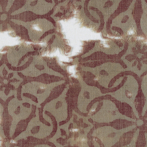 Unbleached cotton with overall pattern in faded red. An overall lattice like effect is created as the petals of flower heads elongate and extend to create an interlaced framework. With smaller eight-petaled flowers in the interstices.