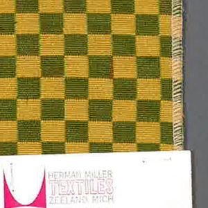 Double cloth in a gold and olive green checkerboard pattern. The warp threads are light brown and dark yellow, and the weft threads are green and yellow. The dark yellow warp and yellow weft intersect and appear as gold. The light brown warp and green weft intersect and appear as olive green.