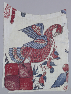 Fragment of mordant-painted and dyed cotton with a Pious Pelican piercing her breast with drops of blood flowing out to three young birds which fly up from the ground below in a row.  Mother pelican is standing on a four-mound.  Leaves and flowers of other motifs on the edges of the fragment.  Colors: red, blue, yellow (faded), dark red.  Outline: black-brown on an ivory background.