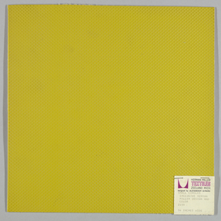Vinyl-coated cotton knit in yellow-green, embossed in an all-over pattern of small circles. Number 2155.
