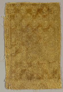 Pattern of leaves in a diamond grid in tan velvet.