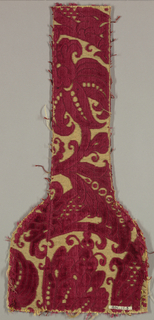 One end of a stole (religious apparel). Large dark red floral design on gold background.