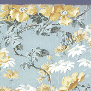 Printed textile showing life-sized pattern of yellow wild roses, daisies, cornflowers, in white and ochre with green foliage on an aqua ground.